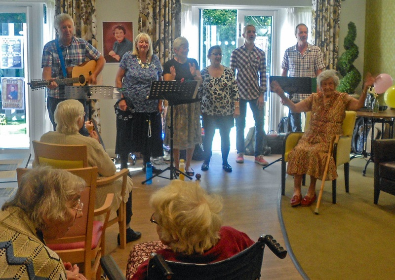 Audrey Merry (seated right) celebrating her 100th birthday at the Skylark home in Horsham. Roger had written a special tribute, 'Happy Birthday Sweet Audrey', which we sang to a familiar Neil Sedaka tune