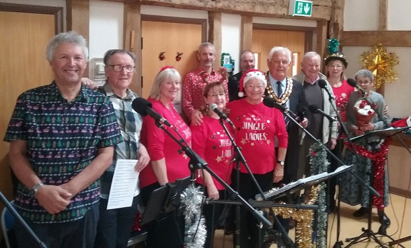 With the Chairman of Horsham District Council Peter Burgess (wearing chain of office), party organiser Debbie Lees and other dignitaries at the Roffey Friendship Group's Christmas do (photo by Robin Christian)